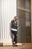Hipster girl standing near column Stock Image