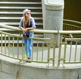 Hipster girl standing on stairs in city Stock Photos