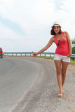 Hipster girl stops the machine by the roadside. The girl stops the car on the road Stock Photo