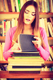 Hipster girl student in college library Stock Photo