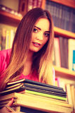 Hipster girl student in college library Royalty Free Stock Images