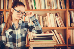 Hipster girl student in college library Royalty Free Stock Image
