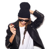 Hipster girl in sunglasses and black beanie  smoke cigar Stock Image