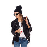 Hipster girl in sunglasses and black beanie smoking cigar Royalty Free Stock Photos