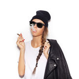 Hipster girl in sunglasses with black leather jacket smoke tobacco Royalty Free Stock Photo
