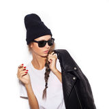 Hipster girl in sunglasses and black leather jacket smoking cigarette Royalty Free Stock Images