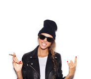 Hipster girl in sunglasses giving the Rock and Roll sign Royalty Free Stock Photo