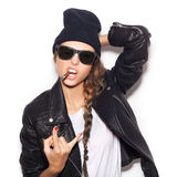 Hipster girl in sunglasses giving the Rock and Roll sign Royalty Free Stock Image