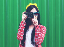 Hipster girl taking photos Stock Photo