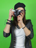 Hipster girl taking a picture with old vintage camera. Stock Image