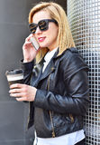 Hipster girl talking on phone Stock Image