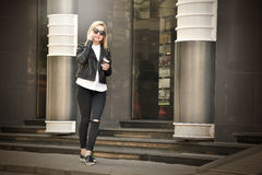 Hipster girl talking on phone Stock Photo