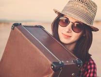 Hipster girl traveler hugging a suitcase Royalty Free Stock Image
