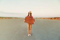 Hipster girl traveler Stock Images