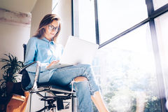 Hipster Girl use Laptop huge Loft Studio.Student Researching Process Work.Young Business Woman Working Creative Startup Stock Photos