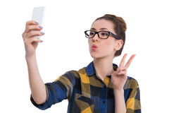 Hipster girl using smartphone Stock Images