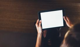 Hipster girl using tablet technology in home atmosphere, girl person holding computer with blank screen on background bokeh, femal. E hands texting on relax stock photos