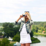 Hipster girl with vintage camera. Modern hipster girl photographed vintage camera outdoors. Lifestyle outdoor portrait Royalty Free Stock Photography