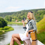 Hipster girl with vintage camera. Modern hipster girl photographed vintage camera outdoors. Lifestyle outdoor portrait Royalty Free Stock Image