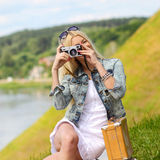 Hipster girl with vintage camera. Modern hipster girl photographed vintage camera outdoors. Lifestyle outdoor portrait Stock Photography