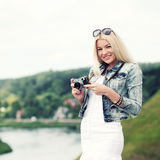 Hipster girl with vintage camera. Modern hipster girl photographed vintage camera outdoors. Lifestyle outdoor portrait Royalty Free Stock Photos