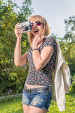 Hipster girl with vintage camera Stock Images
