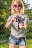 Hipster girl with vintage camera Royalty Free Stock Photos