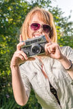 Hipster girl with vintage camera Royalty Free Stock Image