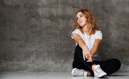 Hipster girl wearing blank white t-shirt, jeans against wall, royalty free stock photos