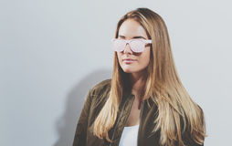 Hipster girl wearing sunglasses Royalty Free Stock Photography