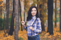 Hipster Girl With Suspenders In Autumn Park Royalty Free Stock Image
