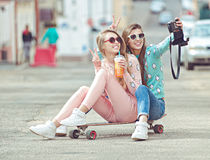 Hipster girlfriends taking a selfie in urban city Royalty Free Stock Photo