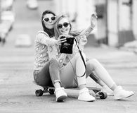 Hipster girlfriends taking a selfie in urban city Royalty Free Stock Photography