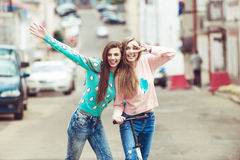Hipster girlfriends taking a selfie in urban city Stock Photography
