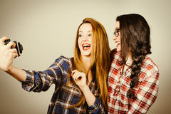 Hipster girls making a selfie with an old camera Royalty Free Stock Photo