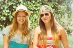 Hipster girls posing outdoors Royalty Free Stock Photo