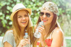 Hipster girls posing outdoors Royalty Free Stock Images