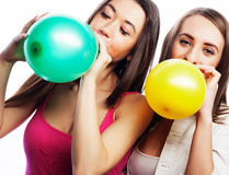 Hipster girls smiling and holding colored balloons Royalty Free Stock Image
