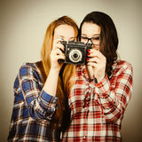 Hipster girls using an old camera Stock Photography