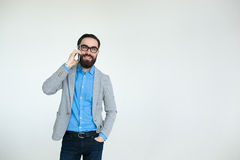 Hipster in glasses talking phone isolated on white background Royalty Free Stock Photos
