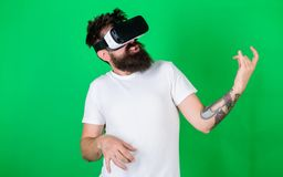 Hipster guitarist on enthusiastic face use modern technology for entertainment. Guy with VR glasses learn to play music. On guitar. VR musician concept. Man stock images