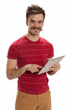 Hipster gunner. Happy, handsome young man with hipster sunglasses, smiles and playfully points his fingers like guns, isolated on white background Stock Image