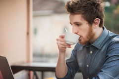 Hipster guy drinking a coffee Stock Photo