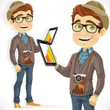 Hipster guy in hat with a tablet computer Stock Images