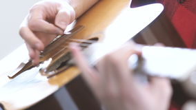 Hipster guy plays acoustic guitar. stock video footage
