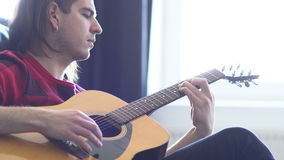 Hipster guy plays acoustic guitar. Music, Sound, Band, Concept stock footage