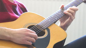 Hipster guy plays acoustic guitar. Slow motion. stock video footage