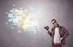 Hipster guy with retro camera in action Royalty Free Stock Photo
