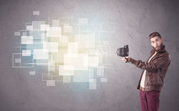 Hipster guy with retro camera in action Royalty Free Stock Photos