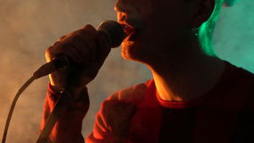 Hipster guy sings on stage in smoke. Music, Sound, Band, Concept stock video footage